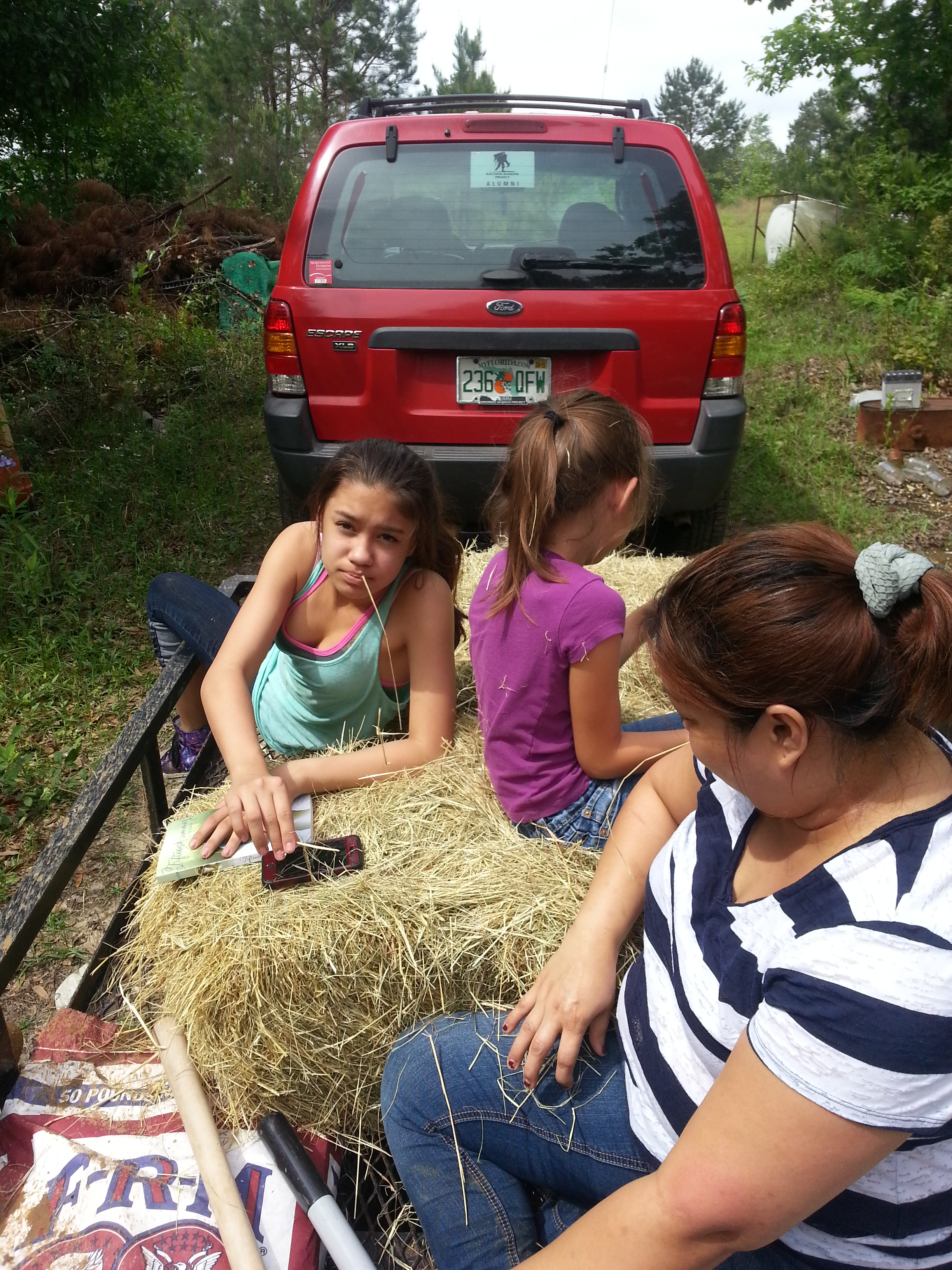 "Girls enjoying a ""Hay Ride"""
